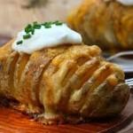 Patatas gratinadas con queso a las finas hierbas